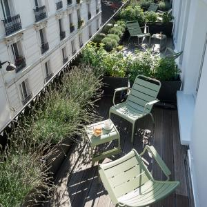 A petite artisan hotel with balconies overlooking the Parisian rooftops - perfection!