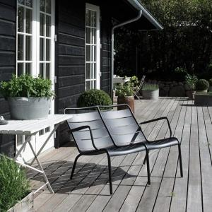 The Luxembourg Duo looking very inviting on the deck of this black timber cottage.<br> image via nordiskrum.dk
