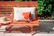 Garden Bench with Cushions on a Sunny Path