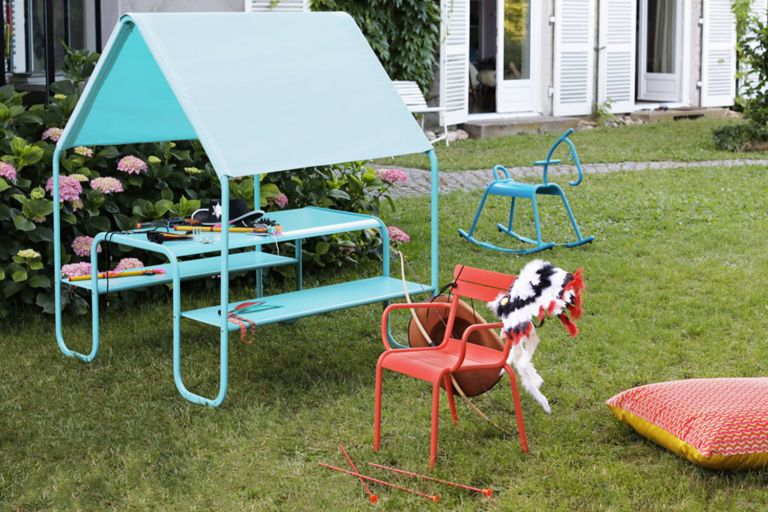 Fermob kids picnic hut bench set in a back yard