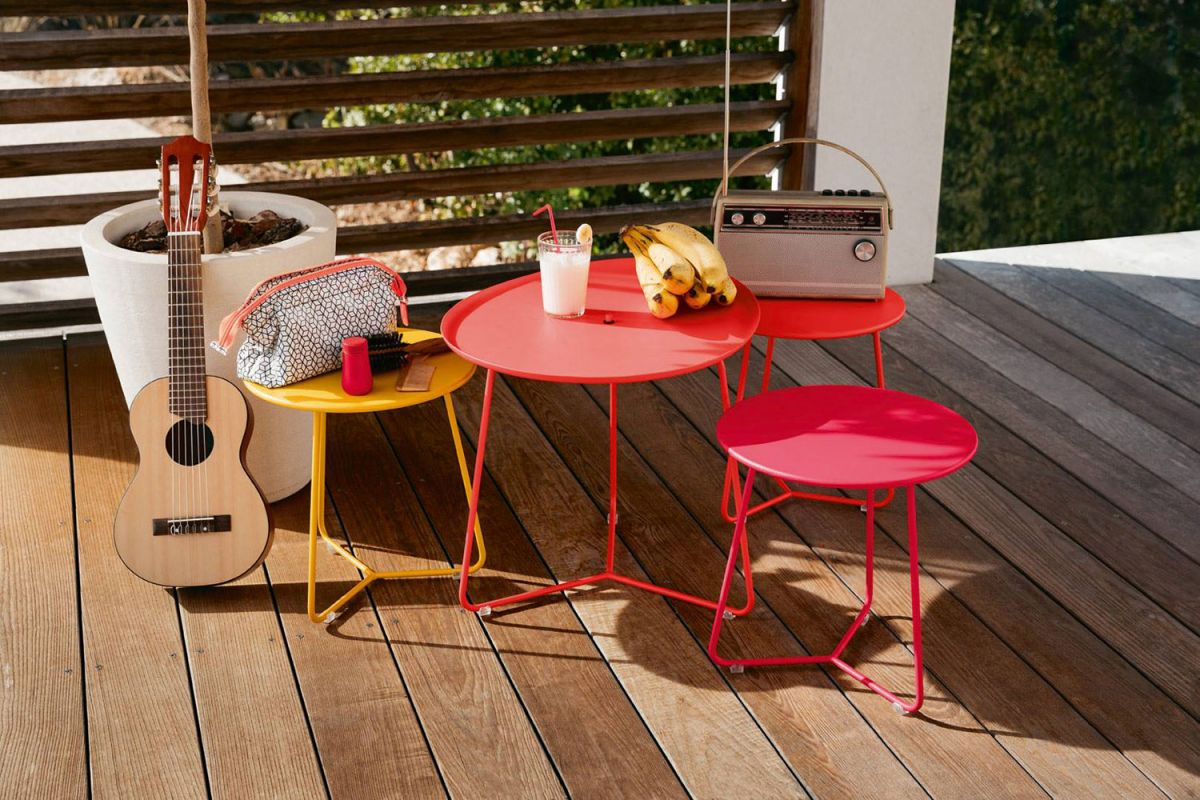 Small Fermob Cocotte stools and side table in bright colours