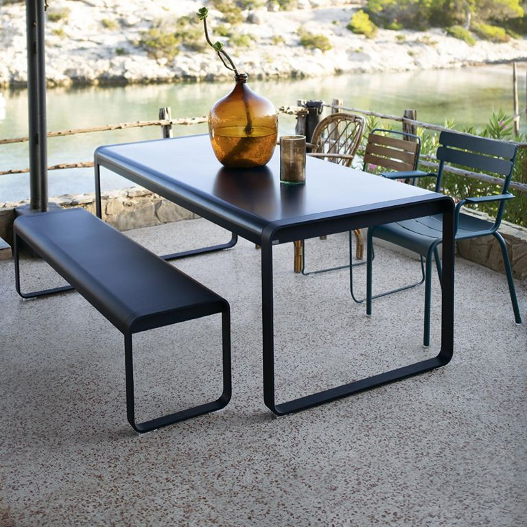 Liquorice black Fermob Bellevie rectangular dining table with bench seat and an assortment of outdoor chairs