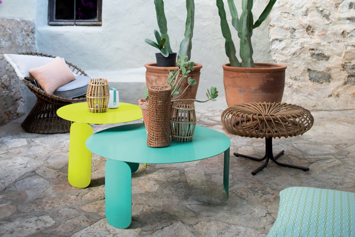 Fermob Bebop round low tables in Verbena and Lagoon Blue in front of terracotta pots