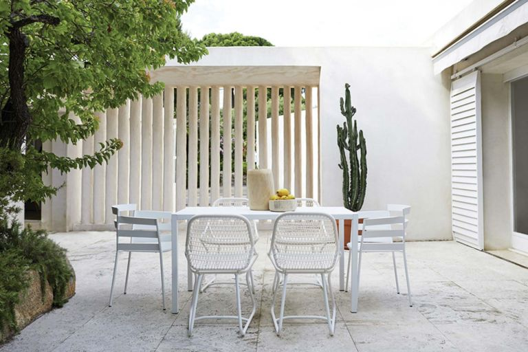 Fermob Sixties outdoor dining chair with a Rythmic chairs around an InsodeOut table in a terrace
