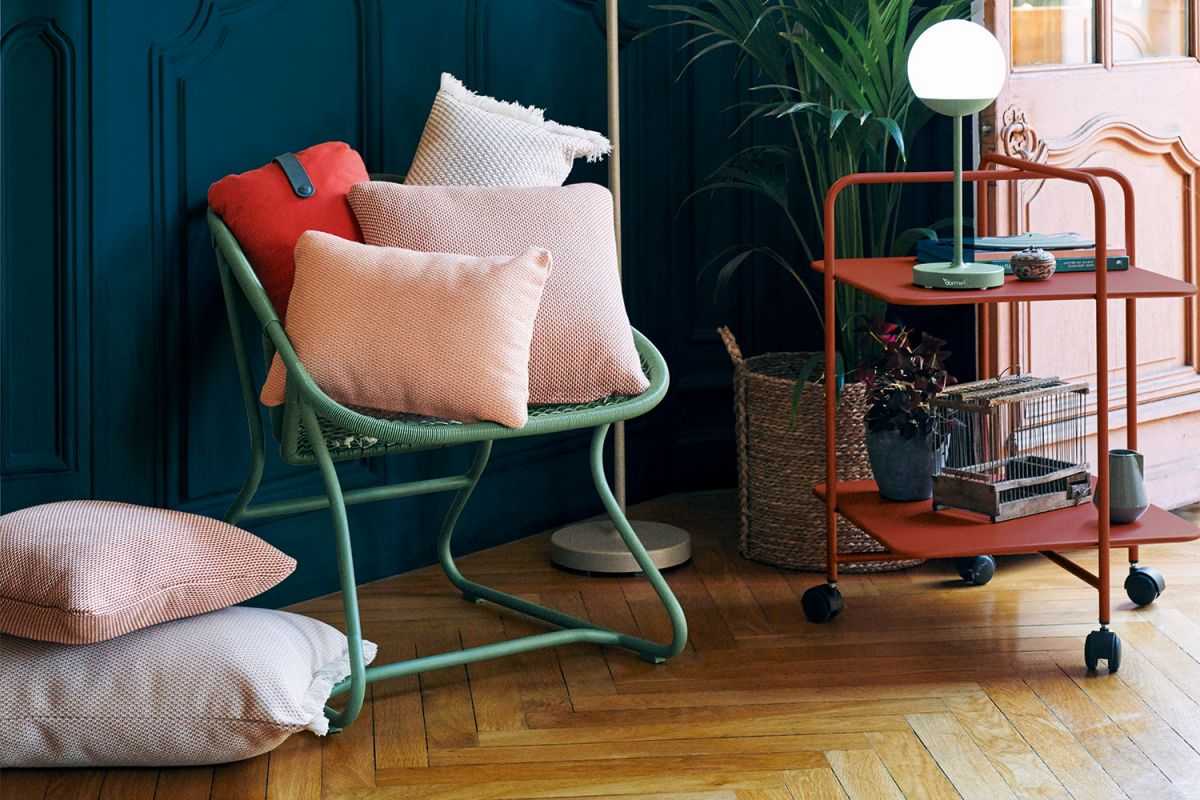 Fermob Sixties armchair in Cactus with Mooon! lamps and Alfred trolley in Red Ocre
