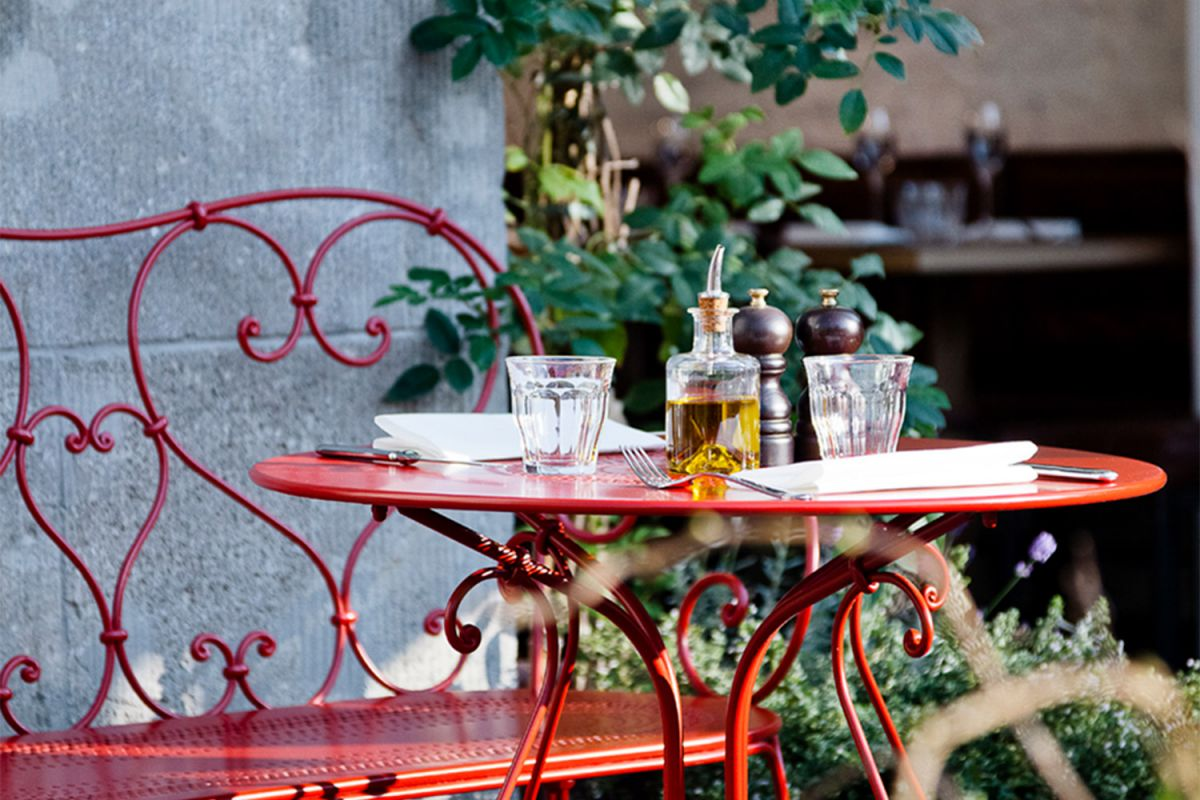 Fermob 1900 Outdoor Table & Bench in Poppy at Restaurant Chan in Berlin