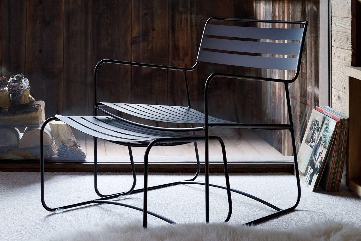 Fermob Surprising Low Armchair and Footrest in Liquorice in a winter cabin
